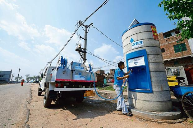A file picture of a Sarvajal Water ATM at Savda Ghevra JJ Colony, New Delhi, being refilled. A clean break from the past could help address the mammoth scale of the social problems, suggest new-age philanthropists.