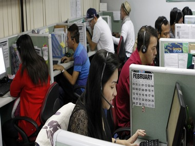 Call center agents work overnight daily to cater to United States clients in Manila's Makati financial district February 6, 2012. The number of Filipinos who work graveyard shifts to answer calls on behalf of big multinational companies like Citigroup and JPMorgan Chase is now greater than India's 350,000, earning the Philippine's the title - Call Centre Capital of the World. By 2016, the Philippines wants to double the size of the local BPO market to $25 billion, employing 1.3 million workers from 640,000 at the end of 2011. But to be able to that the Southeast Asian nation must convince investors it has more to offer than a huge pool of english-speaking talent. Picture taken February 6, 2012. To match Analysis OUTSOURCING/PHILIPPINES REUTERS/Erik De Castro (PHILIPPINES - Tags: BUSINESS EMPLOYMENT) - RTR2Z2A4